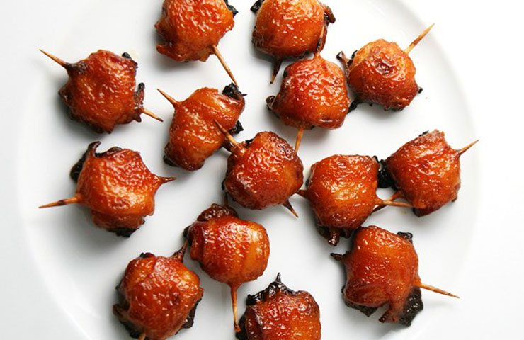 Bacon Wrapped Water Chestnuts Recipe served with a Sweet Dipping Sauce. This appetizer is sweet, salty, out of control delicious and so easy to make!