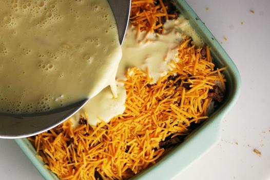 eggpouringcasserole Breakfast Casserole Recipe