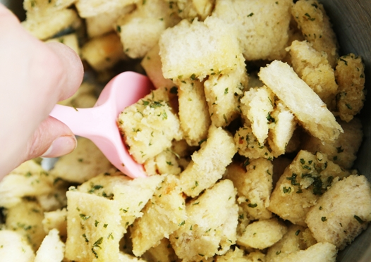 coating croutons with garlic butter Homemade Croutons Recipe