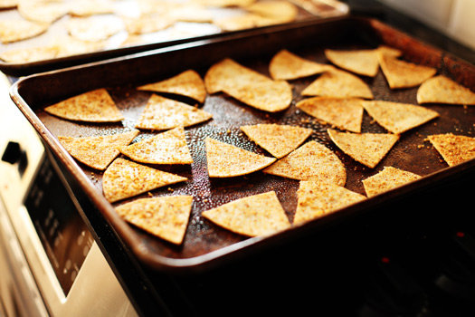 spicy chips on sheet Spicy Baked Flaxseed Tortilla Chips