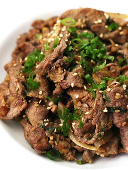This is the best authentic Bulgogi Recipe. The most popular Korean BBQ recipe is bulgogi. Made of thinly sliced beef (usually rib-eye), pre- soaked in bulgogi marinade. Grilled on a barbeque or pan-fried, the tender caramelized pieces of beef bulgogi tastes so amazing and is so easy to make! This AUTHENTIC BULGOGI RECIPE and the Bulgogi sauce is amazing!